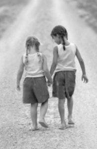 friends-walking-holding-hands-b-w-pic.jpg?w=200&h=308